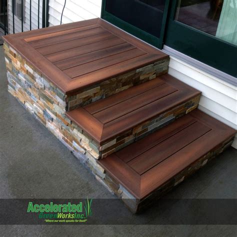 Patio steps with maintenance free decking and a stone