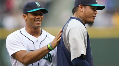 russell wilson bench press russell wilson s first pitch clocked at 98 mph according to safeco field scoreboard