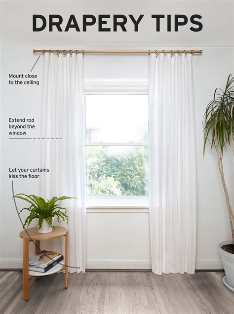 how high to hang curtains how to hang curtains tips from designer andrew pike umbra journal umbra