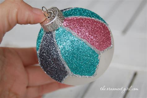 decorate a plain christmas ornament with glitter the