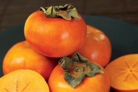 what came the color orange or the fruit for persimmons grower strives to comercialize