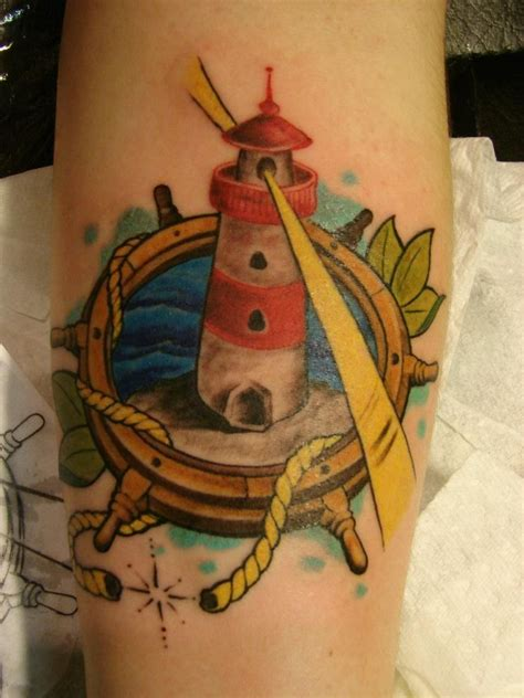 my 5th tattoo my lovely lighthouse done by juran benetti