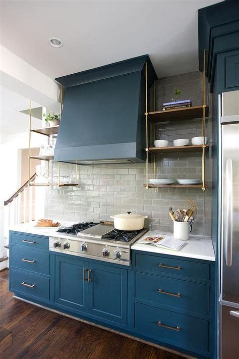 blue cabinets in kitchen blue kitchen cabinets with wood and brass shelves