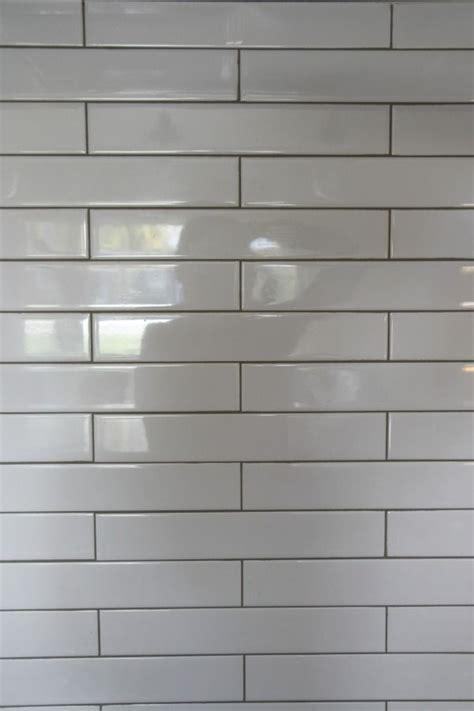 Light Gray Subway Tile by 2x12 White Subway Tile With Light Grey Grout Backsplash 1
