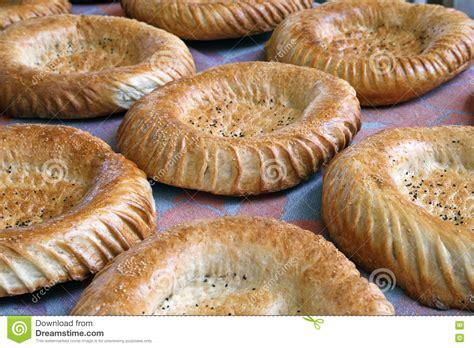 uzbek bread stock photos royalty free images vectors uzbek traditional dish green pilaf in bag on white plate