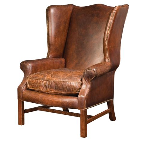 old recliner wingback arm chair in cigar leather