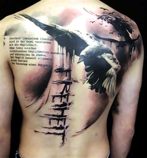 raven tattoo on shoulder blade