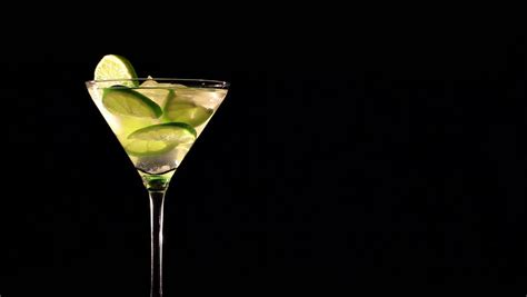 cocktail  ice  lime  black background stock
