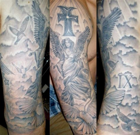religious arm tattoos grey ink cross and religious sleeve