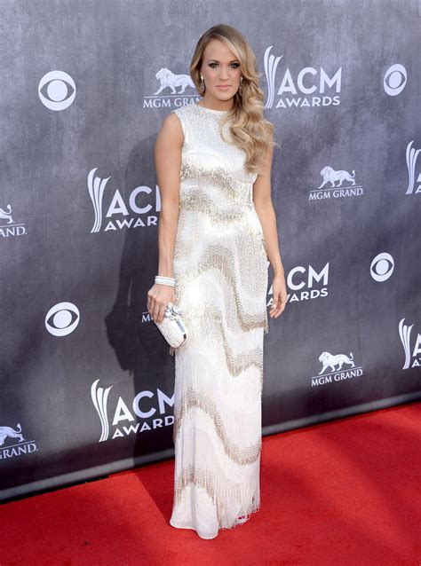 Carrie Underwood With Their Clutches by Carrie Underwood Beaded Clutch Carrie Underwood Handbags