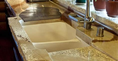 custom concrete countertop complements a log cabin style