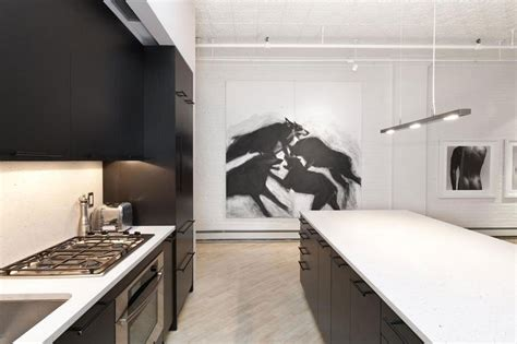 new york modern modern kitchen new york by stylish soho loft in new york features a trendy black and