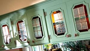who refaces kitchen cabinets update kitchen cabinets with glass inserts hgtv