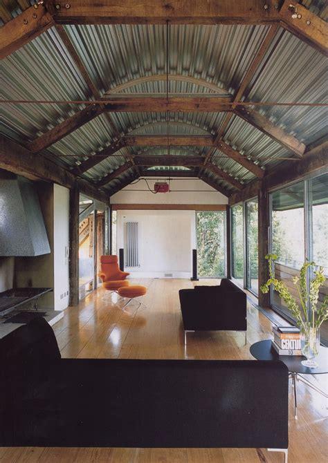 Corrugated metal ceiling basement living room industrial