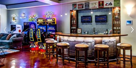 awesome arcade room with full bar is the room you d never