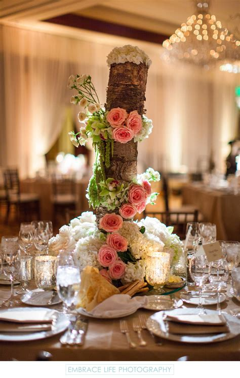 rustic wood centerpiece rustic wood centerpiece draped with flowers wedding