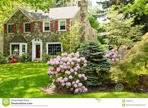 Small Cottage House Plans With Porches family house with beautiful front lawn in spring stock