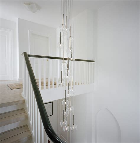 Staircase Lighting Fixtures Stairwell Lighting Staircase Transitional With Black Handrail Light Fixture Chandelier