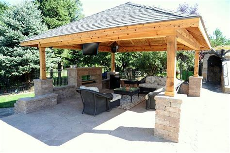 covered patio with fireplace and tv outdoor kitchen