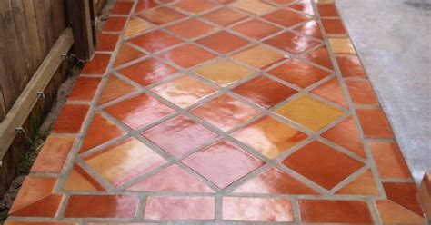 Rustic terra cotta tile flooring with a high gloss finish