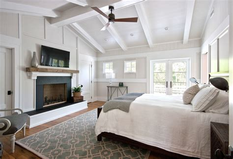 white bedroom with traditional fireplace white bedroom sullivan s island beach house traditional bedroom