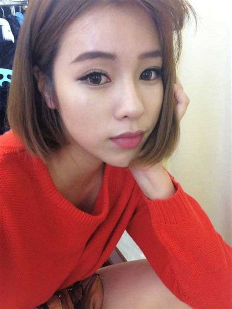 reizende asiatische damen mit bob haare schneidet neue
