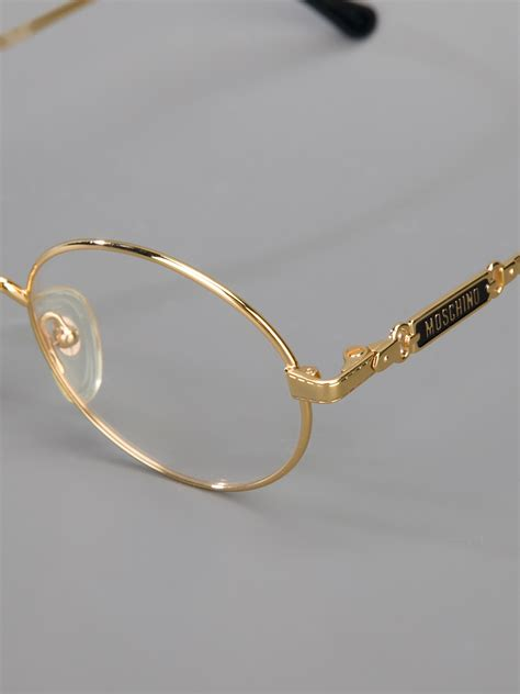 moschino frame glasses in metallic lyst