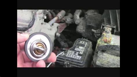 how to replace the thermostat in a 2006 aston martin vanquish s how to replace your vehicle s thermostat 2006 nissan sentra youtube