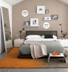 one beige wall and simple shelves above bed bedroom