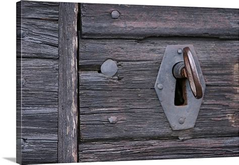 old fashioned lock and key in weathered photo canvas