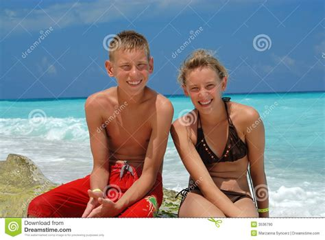 boy teen models happy boy and girl on beach stock photo image 3536790