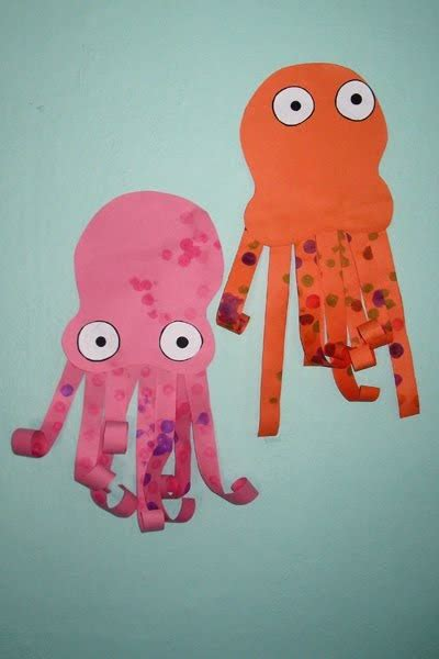 paper octopus craft give your octopus a paintbrush or 8 paper octopus