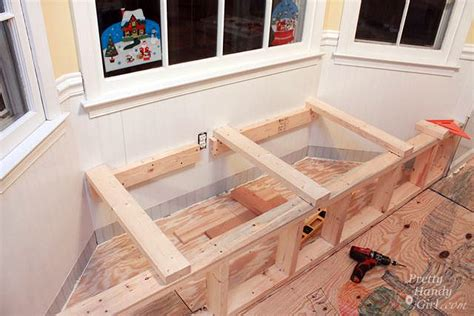 make window building a window seat with storage in a bay window