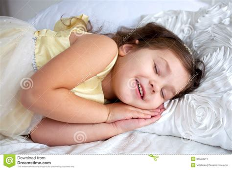 how to get her in bed happy smiling kid sleeping and smiling stock image image