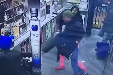 girl pushes & throws an old lady in garbage can in liquor