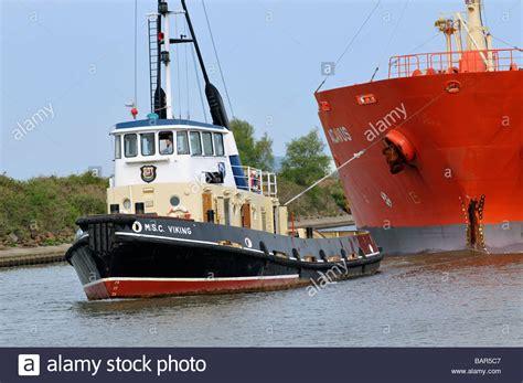 viking tugboat tug boat guiding ship stock photos tug boat guiding ship