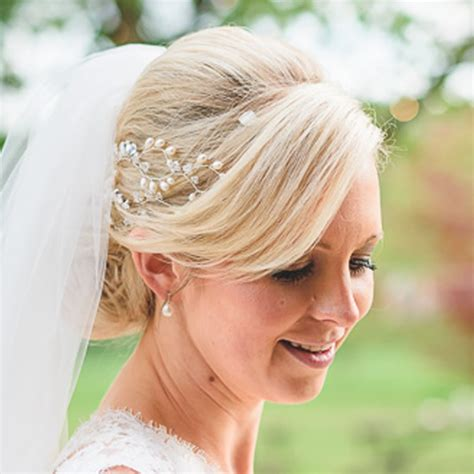 Wedding Hair With Fringe And Veil wedding bun hairstyles wedding hair accessories