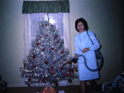 mid century women enjoying aluminum christmas trees