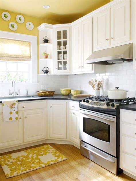 yellow painted kitchen cabinets paint the ceiling or no the decorologist
