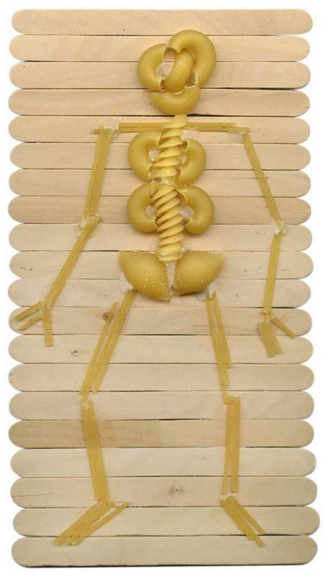 Make A Paper Skeleton - pasta skeleton made with craft sticks and pasta apfk