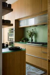 kitchen with bamboo cabinets and resin countertops
