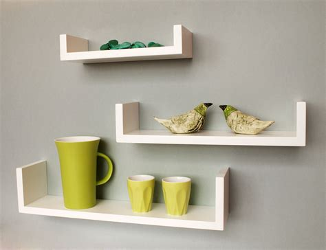 brown wooden floating shelves on white wall design
