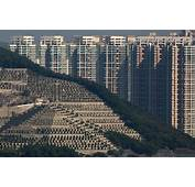 Graves Cover A Hillside In Front Of Apartment Buildings Hong Kong