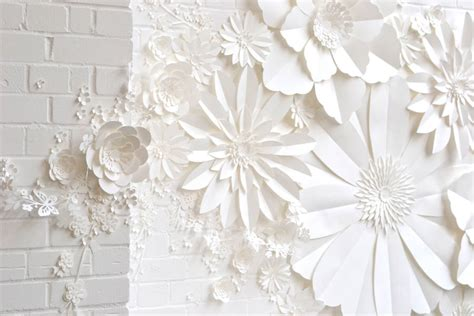 Handmade Paper Wall - handmade paper flower wall installation by may contain