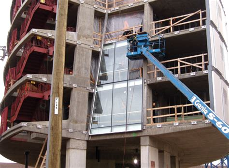 unitized curtain wall installation rise of unitized glass magazine