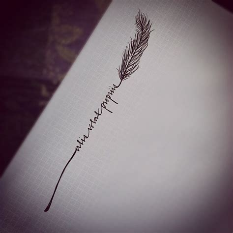 Tattoo Idea   a script writing bookended by a feather or other similar design   cute tattoo