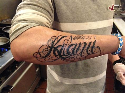 name tattoos on arm for men name forearm tattered artistry tattoos