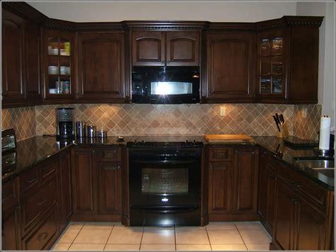 cream colored kitchen cabinets  black appliances