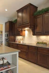 burrows cabinets kitchen  knotty alder georgian vent hood