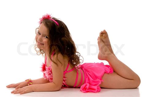 lying naked on the bathroom floor little girl in the pink bathing suit lying on the floor